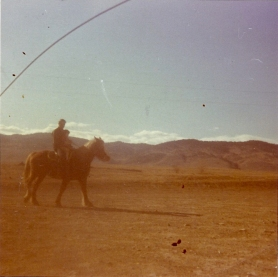 My dad and me. Boulder, CO. 1969. A blurry photo of my first ride.